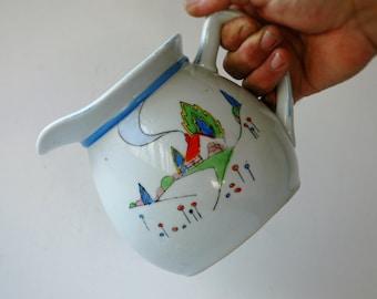 Japan made large milk jug with handpainted cottage scene