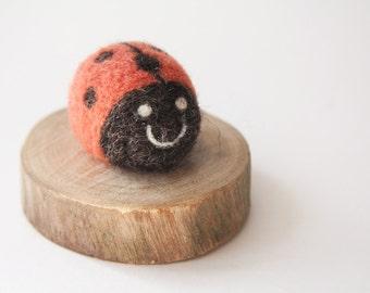 Needle felt ladybird on wood
