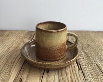 Handmade ceramic espresso cup and saucer.