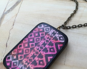 pink zig zag pendant on oxidized copper chain