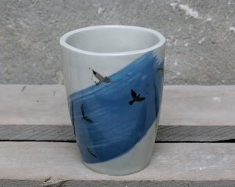 Large cup of stoneware with transferred image of birds flying. Handmade