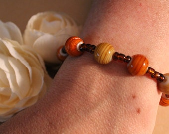 Unique and Whimsical Orange and Brown Beaded Bracelet