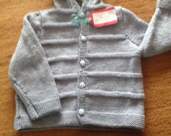 Baby boy's hooded jacket with football buttons. Now reduced in price!