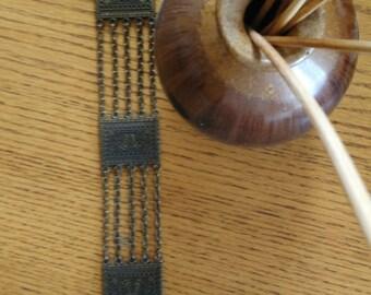 belt (belt) with bronze designs