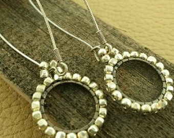 Hand stitched silver hoop earrings