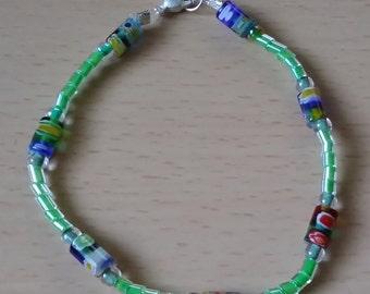 Green and blue flowered glass bead bracelet