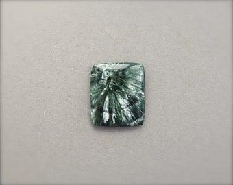 Seraphinite Cabochon. Iridescent green gemstone.