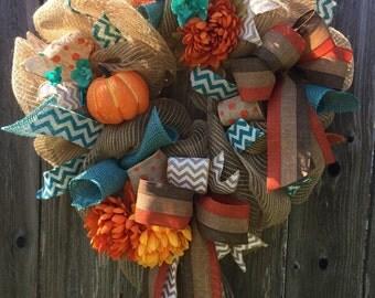 Orange and teal fall wreath
