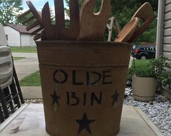 Primitive old bin with utencils