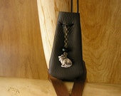 "Racoon, walnut leather drawstring pouch with a ceramic charm, 3"" x 1 1/2"" adjustable 36""  neck cord"