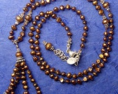 Hand knotted golden bronze 2x4mm fresh water pearls and Bali sterling silver beaded tassle pendant necklace