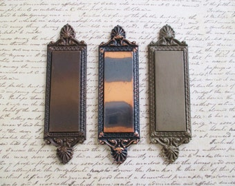 Three Vintage Cast Metal Russell & Erwin Decorative Pieces