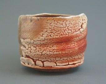 Nodate Chawan, wood-fired iron rich stoneware with crawling shino and natural ash glazes