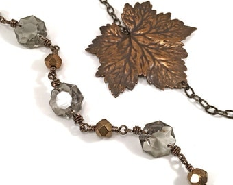 Long necklace, asymmetrical with leaf and chandelier crystals, antique bronze, gunmetal and topaz grey