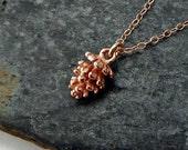 rose gold pine cone. 24k rose gold vermeil, rustic artisan charm. adirondack jewelry. sacred geometry jewelry. yoga jewelry. gold pinecone.