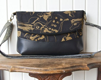 Freesia Foldover Cross body bag in  Black and Gold Metallic Carkai with black faux leather