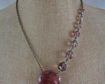 Asymmetrical purple glass necklace