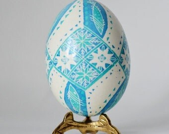 Blue Pysanka with fish designs Ukrainian Easter egg real chicken egg shall hand painted in traditional christian way with 8 point stars