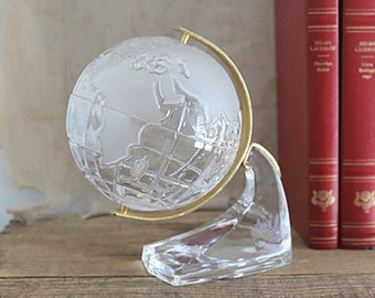 Vintage rotating clear glass world globe on stand