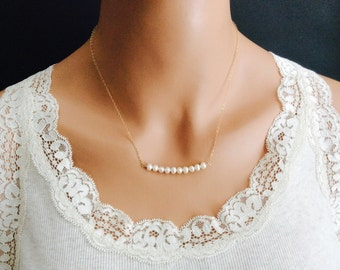 Pearl Necklace In 14K Gold Filled With Ten Rows Of White Freshwater Pearls