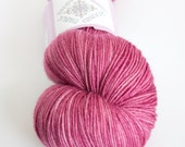 Light pink hand-dyed fingering weight yarn   Round Table Yarns Gawain in Lunete