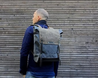 Waxed canvas backpack / rucksack with folded top and padded shoulder straps