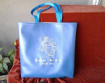 Mermaid embroidered on blue vinyl tote bag