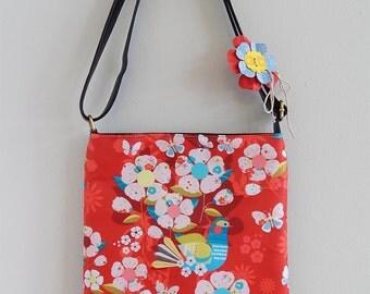 Spring blossom bag on red, leather sling bag