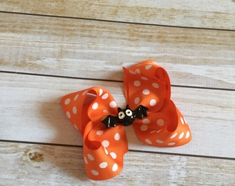 Orange Polka Dot Halloween Boutique Style Hair Bow with a Black Bat Center