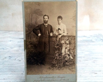 The Antique couple photograph, formal portrait from the 1800s. Victorian photograph.