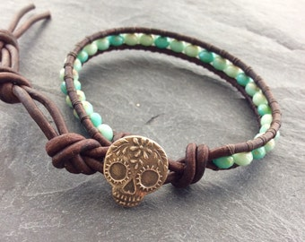 Sugar skull skinny bracelet - leather wrap, Anne Choi bronze button, layering stacking boho jewelry by mollymoojewels
