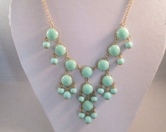 Bib Necklace with Light Turquoise Bead Pendants on a Gold Tone Chain