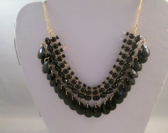 SALE Bib Necklace with Black Teardrop Beads and Crystal Like Beads on a Gold Tone Chain