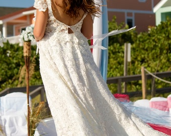 ivory lace cap sleeve with low plunging v back ball gown