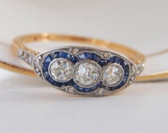 SOLD, DECEMBER PAYMENT Fabulous Art Deco Vintage Engagement Ring. 3 Old European Diamonds with Baguette Sapphire Halo.