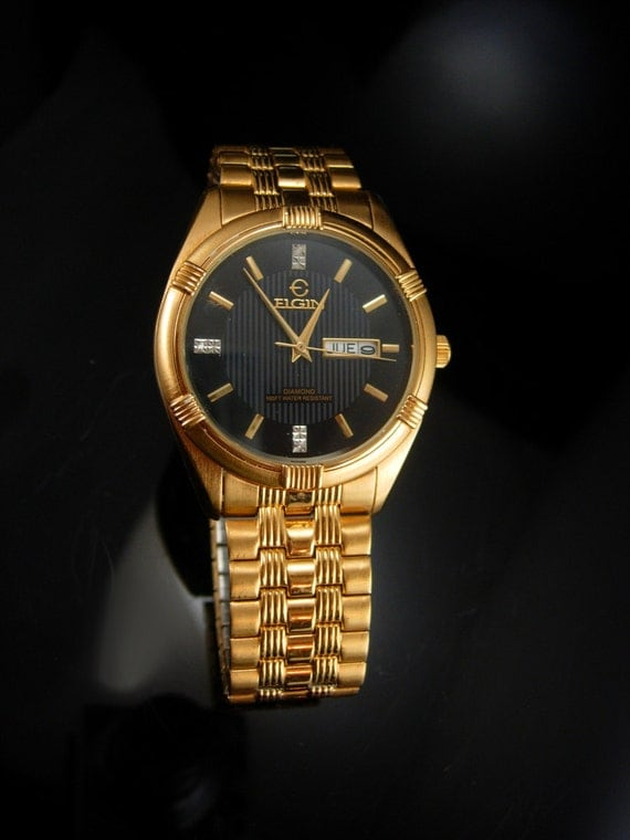 elgin mens wrist gold with date stretch band