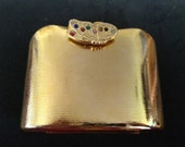 perfectly perfect little gold clutch with butterfly closure detail