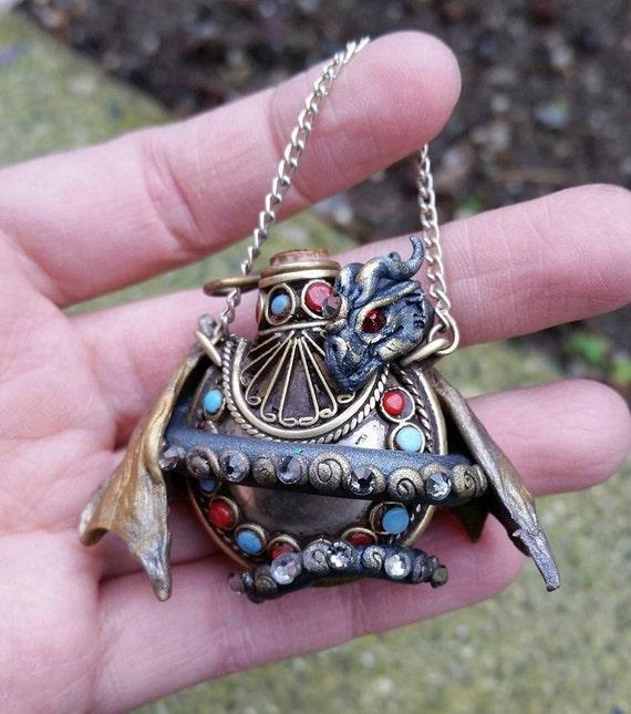 Tibetan Vessel Dragon Pendant