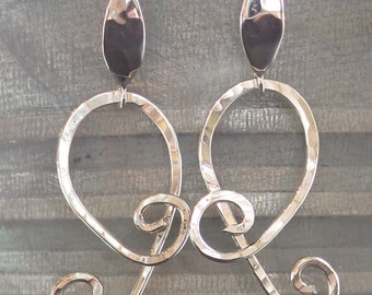 Handmade Sterling Silver hammered swirl spiral curved earrings on a hammered sterling silver earring back
