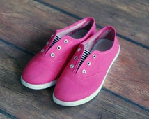 Raspberry red shoelace-less plimsolls