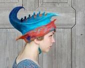Unique fancy felted hat , designer hat, sculptural hat with 3D elements, blue turquoise hat with orange brim. OOAK