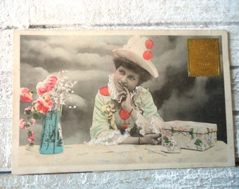 Antique Colombine postcard - Woman clown costume, hat pompons, table box vase flowers, Pierrette Edwardian, gold stamp, french tinted 1900