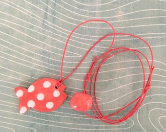 Lanyard pendant necklace with red and white ceramic shaped tangerine pink fish