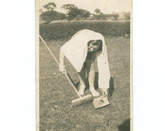 Vintage Humorous Photograph Of A woman Sweeping Grass in a Field c1930s RPPC