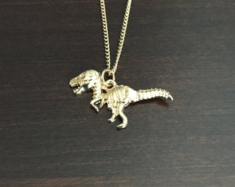 dinosaur, dinosaur necklace, dinosaur jewelry, gold dinosaur, t rex, t rex necklace, trex, animal necklace, animal jewelry, animal pendant