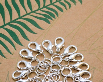 Jewellery findings 12 x 14 mm lobster clasps and 24 x 6 mm jump rings 36 pieces of silver alloy good quality findings bundle