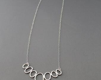 Pebbles necklace. Seven Pebbles.handemade sterling silver handemade