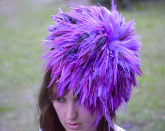Fascinator , purple feathers, clip and elastisk band
