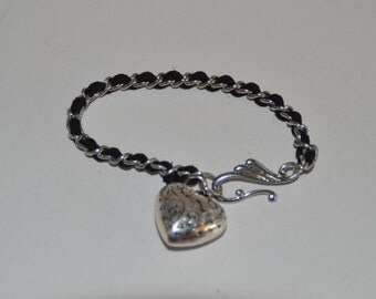 Bracelet: Classy Metal Chain Woven With Black Suede Bracelet With Huge Heart Charm (BMC021)