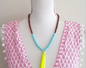 Tassel necklace - Neon yellow beaded tassel necklace with turquoise and dark wooden beads. Elastic. stretches. Neon yellow tassel.
